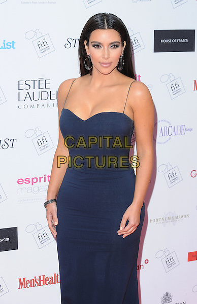 Kim Kardashian.The FiFi UK Fragrance Awards 2012 at The Brewery, Chiswell Street, London, England..May 17th 2012.half length dress blue black cleavage  hoop earrings .CAP/BEL.©Tom Belcher/Capital Pictures.