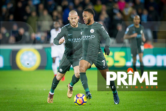 Raheem Sterling and David Silva of Manchester City break during the EPL - Premier League match between Swansea City and Manchester City at the Liberty Stadium, Swansea, Wales on 13 December 2017. Photo by Mark  Hawkins / PRiME Media Images.