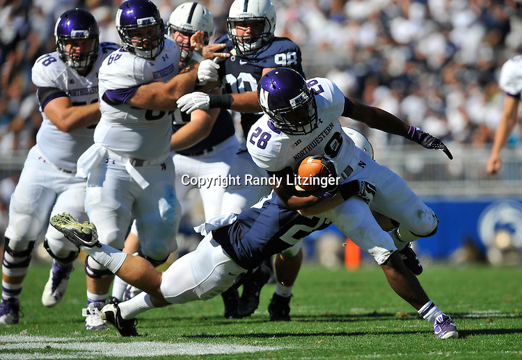 27 September 2014:  Northwestern RB Justin Jackson (28) runs through a tackle by Penn State S Ryan Keiser (23). The Northwestern Wildcats defeated the The Penn State Nittany Lions 29-6 at Beaver Stadium in State College, PA.