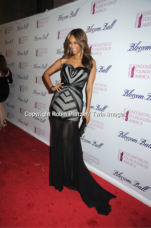 Tyra Banks in Francis Libiran black dress attends the Endometriosis Foundation of America 4th Annual  Blossom Ball on March 15, 2012 at The New York Public Library in New York City.