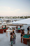 BERMUDA, Hamilton. Guests at the 1609 Bar and Restaurant of the Hamilton Princess & Beach Club.
