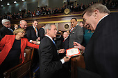 US President George W. Bush (C) signs autographs after delivering the final State of the Union address of his presidency at the US Capitol in Washington 28 January 2008.     .Credit: Tim Sloan - Pool via CNP