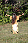 Native American Indian boy with his arms up worshiping