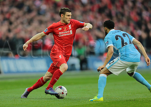 28.02.2016. Wembley Stadium, London, England. Capital One Cup Final. Manchester City versus Liverpool. Liverpool Midfielder James Milner takes on Manchester City Defender Gaël Clichy