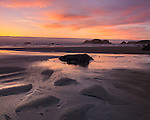 Bandon State Park, Oregon: Twilight reflections at low tide with silhouetted seastacks at Bandon Beach