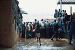 South Africa 2 Algeria 1, 27/01/1996. FNB Stadium, Johannesburg. African Cup of Nations quarter-final, South Africa 1996. Fans watch in the rain. Photo by Tony Davis
