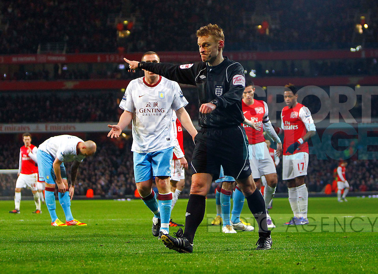 Referee Michael Jones awards Arsenal their second penalty.Arsenal v Aston Villa in the FA Cup with Budweiser 4th Round, at the Emirates Stadium, London, 29th January 2012.--------------------.Sportimage +44 7980659747.picturedesk@sportimage.co.uk.http://www.sportimage.co.uk/.Editorial use only. Maximum 45 images during a match. No video emulation or promotion as 'live'. No use in games, competitions, merchandise, betting or single club/player services. No use with unofficial audio, video, data, fixtures or club/league logos.