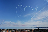 The Red Arrows form a heart during their performance for the Wales National Air Show in Swansea, Wales, UK. Saturday 30 June 2018