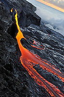 River of molten lava flowing to the sea at sunrise, Kilauea Volcano, Big Island, Hawaii Islands, Usa