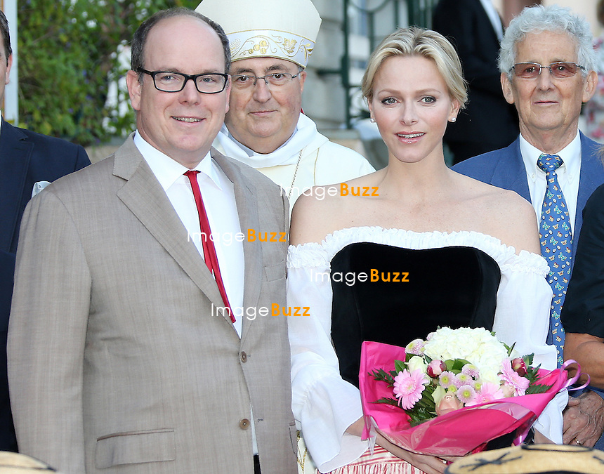 Monaco (MC)-TT. SS. HH. Prince Albert and Princess Charlene of Monaco and princess Caroline attend the traditional Picnic of the Principality in the Princess Antoinette Park. Princess Charlene appeared for the first time wearing the traditional dress of Monaco.<br /> September 13, 2013.