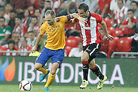 Athletic de Bilbao's Carlos Gurpegui (r) and FC Barcelona's Andres Iniesta during Supercup of Spain 1st match.August 14,2015. (ALTERPHOTOS/Acero)