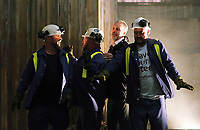 "Pictured: The four main characters perform a dance scene<br /> Re: Press rehearsal of ""We'Re Still Here"", a play created by Rachel Trezise, Common Wealth and the National Theatre Wales about steelworkers, which will be performed in Byass Works, a disused industrial unit, in Port Talbot, south Wales, UK."