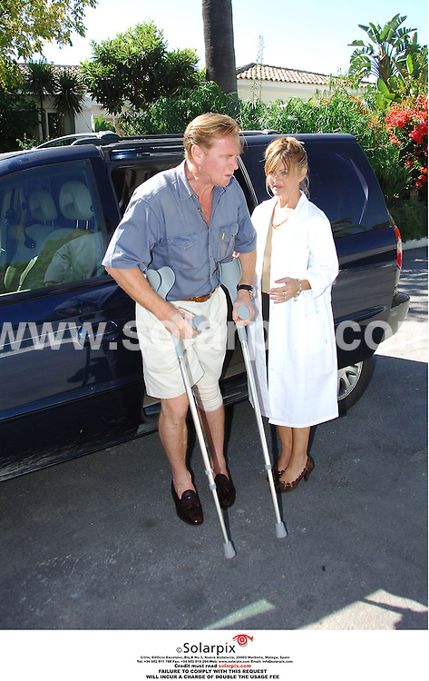 PICTURES BY SOLARPIX.COM.**MUST CREDIT SOLARPIX.COM OR DOUBLE FEE WILL BE CHARGED**.James Hewitt leaving hospital after his recent accident leaving him with twenty seven stitches but in good humour shown here charming his nurses..DATE:05_10_06-JOB REF:2881-JGS
