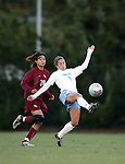 Carolina's Kacey White (9) plays the ball while being chased by Florida State's Mami Yamaguchi (20) on Friday, November 25th, 2005 at Fetzer Field in Chapel Hill, North Carolina. The Florida State Seminoles defeated the University of North Carolina Tarheels 5-4 on penalty kicks after the teams tied 1-1 after overtime during their NCAA Women's Soccer Tournament quarterfinal game.