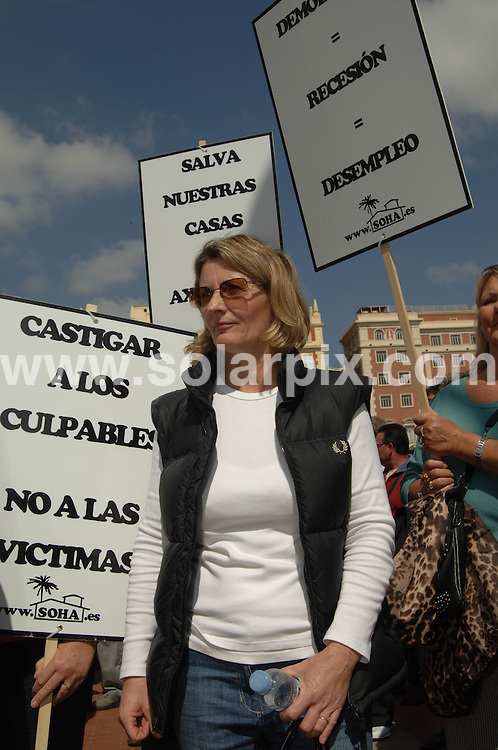 **ALL ROUND EXCLUSIVE PICTURES FROM SOLARPIX.COM**.**WORLDWIDE SYNDICATION RIGHTS**.Expats in Spain demonstrate in the centre of Malaga campaigning for the legalisation, and against demolition, of their homes. Around 1000 people marched through the main shopping street in the city, and then around the centre. Malaga, Spain. 17 March 2010..This pic: Teresa Atkinson..JOB REF: 10911 IST     DATE: 17_03_2010.**MUST CREDIT SOLARPIX.COM OR DOUBLE FEE WILL BE CHARGED**.**MUST AGREE FEE BEFORE ONLINE USAGE**.**CALL US ON: +34 952 811 768 or LOW RATE FROM UK 0844 617 7637**