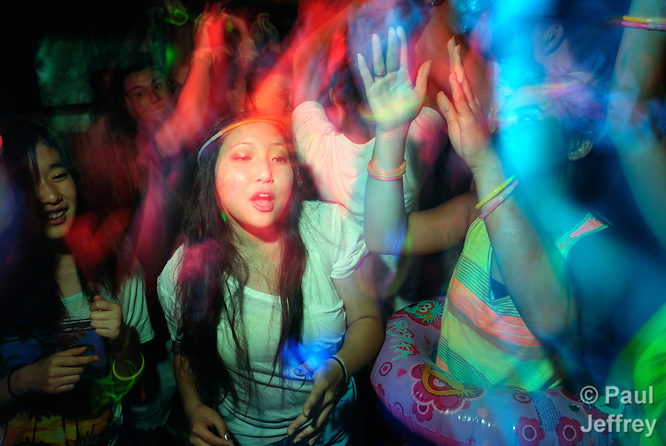 Participants dance during the 2013 Asian American Camp for United Methodist youth in the west of the United States. The camp was held at Camp Sierra in Big Creek, California.