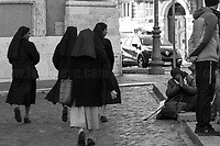 Unknown, Nuns (Keep Walking...).<br /> <br /> Rome, 01/05/2019. This year I will not go to a MayDay Parade, I will not photograph Red flags, trade unionists, activists, thousands of members of the public marching, celebrating, chanting, fighting, marking the International Worker's Day. This year, I decided to show some of the Workers I had the chance to meet and document while at Work. This Story is dedicated to all the people who work, to all the People who are struggling to find a job, to the underpaid, to the exploited, and to the people who work in slave conditions, another way is really possible, and it is not the usual meaningless slogan: MAKE MAYDAY EVERYDAY!<br /> <br /> Happy International Workers Day, long live MayDay!