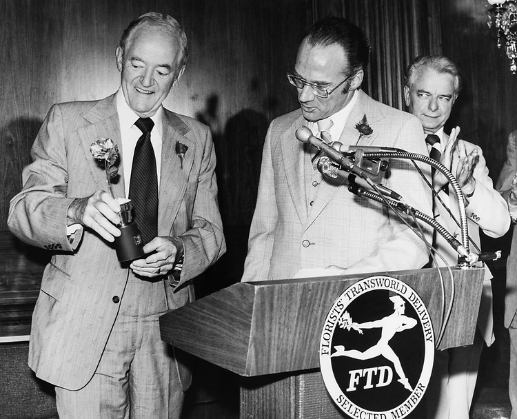 Sen. Hubert Humphrey, D-Minn., holding trophy with party member in 1975. (Photo by CQ Roll Call)