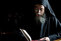 Mount Athos - The Holy Mountain.<br /> A monk prays in the church of Pantokratoros.<br /> <br /> Photographer: Rick Findler