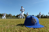 South Dakota State JackRabbits players warmup with a hat lying in the grass a game against the Maine Black Bears at South County Regional Park on March 9, 2014 in Port Charlotte, Florida.  Maine defeated South Dakota 5-4.  (Mike Janes/Four Seam Images)
