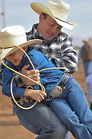 gr-lastrodeo0212 01311143sp 2/5/11 Jason Jonovich (cq) of Tonopah wrestles with his son Travis Jonovich (cq), 11, during the junior competitions at the Gilbert Rodeo Park. .(Yfat Yossifor / The Arizona Republic)