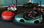 Palestinians take a ride at an amusement park on the third day of Eid al-Adha or the feast of sacrifice in Khan Younis in the southern of Gaza strip, on August 2, 2020. Muslims are celebrating Eid al-Adha (the feast of sacrifice), the second of two Islamic holidays celebrated worldwide marking the end of the annual pilgrimage or Hajj to the Saudi holy city of Mecca. Photo by Ashraf Amra