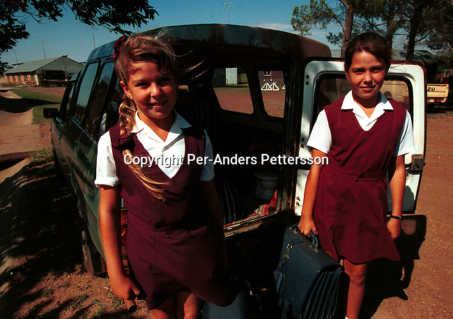 Two unidentified Afrikaner girls being picked up b ytheir mother at a private school on March 11, 1997 in Venderstorp a conservative farming town 200 kilometers west of Johannesburg, South Africa..The black pupils form the poor township was intergrated after the democratic election in 1994. Most white students changed to private schools in the area. .(Photo: Per-Anders Pettersson/ Getty Images)