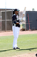 Carlos Peguero #64 of the Seattle Mariners participates in spring training workouts at Peoria Sports Complex on February 27, 2011  in Peoria, Arizona. .Photo by:  Bill Mitchell/Four Seam Images.