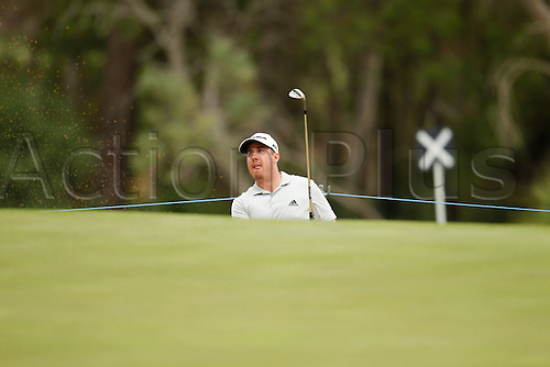 28.02.2016. Perth, Australia. ISPS HANDA Perth International Golf. Ryan Evans (ENG) watches his bunker shot at the 4th during his final round.