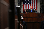 WASHINGTON, DC - JANUARY 30:  U.S. President Donald J. Trump waves during the State of the Union address as U.S. Vice President Mike Pence (L) and Speaker of the House U.S. Rep. Paul Ryan (R-WI) (R) look on in the chamber of the U.S. House of Representatives January 30, 2018 in Washington, DC. This is the first State of the Union address given by U.S. President Donald Trump and his second joint-session address to Congress.<br /> Credit: Win McNamee / Pool via CNP