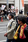 """March 10, 2013, Tokyo, Japan -  Protestors jeer at protesting rivals during the """"Zero Nukes"""" rally in downtown Tokyo. The day before the second-year anniversary of the Great East Japan Earthquake and TEPCO Fukushima Daiichi nuclear power plant accident of March 11, 2011. The rally is held by Metropolitan Coalition Against Nukes which was formed in September 2011. (Photo by Rodrigo Reyes Marin/AFLO).."""