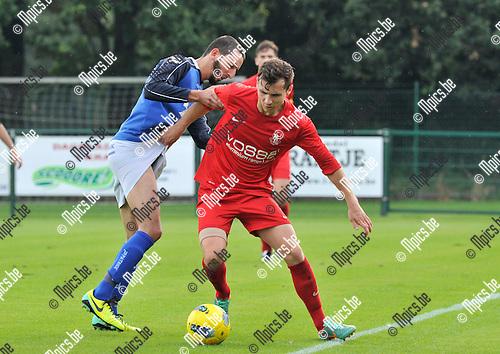 2014-07-27 / voetbal / seizoen 2014-2015 / Vosselaar - Mariekerke / Een duel om de bal tussen Admir Krajisnik (r) (Vosselaar) en Noureddine Ben Omar (l) (Mariekerke)