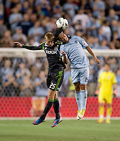 Roger Espinoza (15) of Sporting Kansas City goes up for a header with Andy Rose (25)  of the Seattle Sounders during the game at Livestrong Sporting Park in Kansas City, Kansas.   Sporting Kansas City won the Lamar Hunt U.S. Open Cup on penalty kicks after tying the Seattle Sounders in overtime.