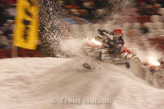 Trent Nelson  |  The Salt Lake Tribune.Racers fly into the corner while competing in the Semi Pro Super Stock race at the Western Nationals of the AMSOIL Championship Snocross Series at Rio Tinto Stadium in Sandy, Saturday, January 9, 2010.