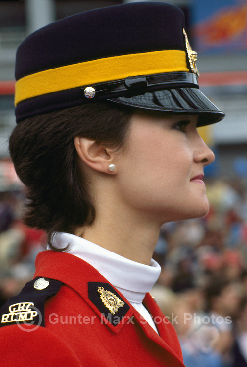 Female Canadian Mountie, Royal Canadian Mounted Police (RCMP) Officer wearing Traditional Red Surge Uniform and standing at Attention, Vancouver, BC, British Columbia, Canada (No Model Release Available)