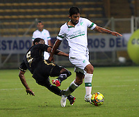 BOGOTA -COLOMBIA. 10-03-2014.  Cristian Marrugo (Der)  del Deportivo Cali   disputa el balon contra Juan Guaza  de Fortaleza F.C.  partido por la decima   fecha de La Liga Postobon 1 disputado en el estadio Metropolitano de Techo . /  Cristian Marrugo (R) of Deportivo Cali  fights the ball  against Juan Guaza  of Fortaleza F.C.  of  tenth round during the match  of The Postobon one league  at the Metropolitano of Techo Stadium . Photo: VizzorImage/ Felipe Caicedo / Staff