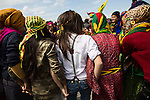 Women dance together at Newroz, the Kurdish New Year celebration, in Viranşehir, Turkey, March 18, 2015. Newroz, or Nowruz, is an ancient holiday celebrated by a multitude of ethnic groups across Iran, Central Asia, and the Caucuses, and ushers in the first day of Spring, March 21. For Kurds, Newroz is a means of political and cultural expression, featuring Kurdish politicians, activists, and musicians, and has become a manifestation of Kurdish identity. In Turkey, the celebrations begin a few days before the Vernal Equinox, culminating in a huge gathering in the heart of Turkey's Kurdish population, the southeastern city of Diyarbakir. This year, PKK founder Abdullah Öcalan, who despite serving a life sentence for treason still enjoys widespread influence among Kurds, sent a letter that was read at Newroz in Diyarbakir, calling for an end to the PKK's armed struggle against the Turkish state.
