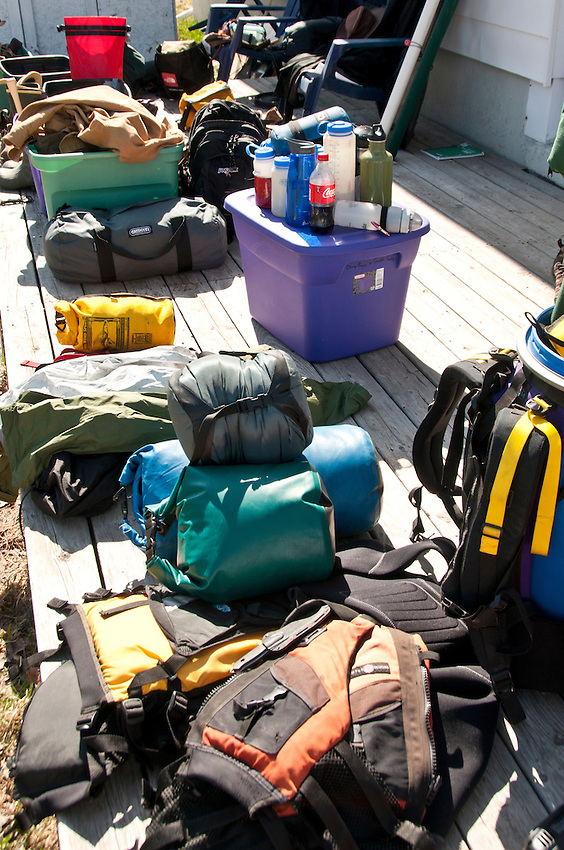 Outdoor equipment spread out while preparing for a wilderness trip.