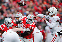 Ohio State Buckeyes defensive tackle Michael Bennett (63) pressures Indiana Hoosiers quarterback Zander Diamont (12) into a pass in the second quarter of the college football game between the Ohio State Buckeyes and the Indiana Hoosiers at Ohio Stadium in Columbus, Saturday afternoon, November 22, 2014. The Ohio State Buckeyes defeated the Indiana Hoosiers 42 - 27. (The Columbus Dispatch / Eamon Queeney)