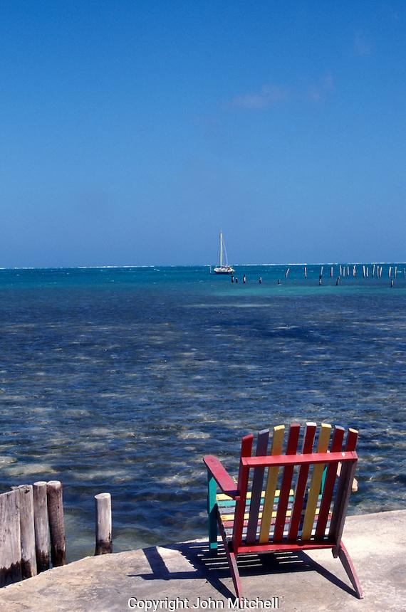 Deck chair overlooking the Caribbean Sea on Caye Caulker, Belize