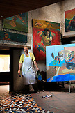 BRAZIL, Rio de Janiero, Bob Nadkarni with several of his paintings, Favela Tavares Bastos