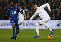 Demarai Gray of Leicester City closely marks Alfie Mawson of Swansea City during the Premier League match between Swansea City and Leicester City at The Liberty Stadium, Swansea, Wales, UK. Sunday 12 February 2017