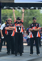 Apr. 29, 2012; Baytown, TX, USA: NHRA pro stock driver Erica Enders raises her hands to celebrate the round win by teammate Dave Connolly (not pictured) during the Spring Nationals at Royal Purple Raceway. Mandatory Credit: Mark J. Rebilas-
