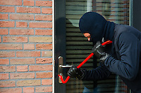 Burglar carrying the tool of choice