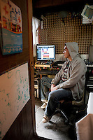 Antonio Zúñiga, released 2 years ago after serving almost 2.5 years of a life sentence for a murder he was later proved innocent of committing.  He sits here in his improvised home recording studio, he now lives 2 blocks from where he we=as picked up by the police and is a rapper. Iztapalapa, Mexico D.F.