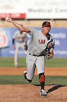 Jake Smith #54 of the San Jose Giants pitches against the High Desert Mavericks at Heritage Field on August 31, 2014 in Adelanto, California. High Desert defeated San Jose, 9-6. (Larry Goren/Four Seam Images)