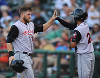 NWA Democrat-Gazette/ANDY SHUPE<br /> Arkansas Travelers first baseman Kyle Waldrop (left) is congratulated by shortstop Joey Wong after scoring a run  Saturday, June 10, 2017, during the fourth inning at Arvest Ballpark in Springdale. Visit nwadg.com/photos to see more photographs from the game.