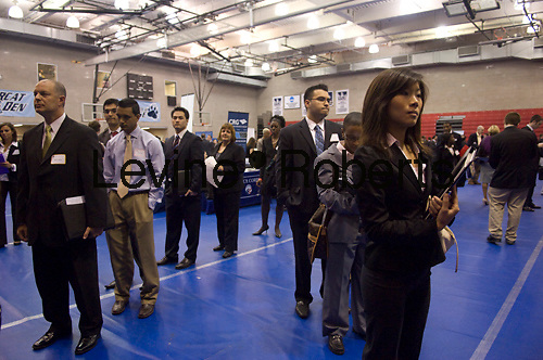 Job seekers attend the MyWorkster Multi School Alumni Job Fair at Baruch College in New York on Thursday, June 4, 2009. The Department of Labor announced that  the unemployment insurance rolls diminished slightly for the first time in 20 weeks, falling by 15,000 to 6.7 million.(© Frances M. Roberts)