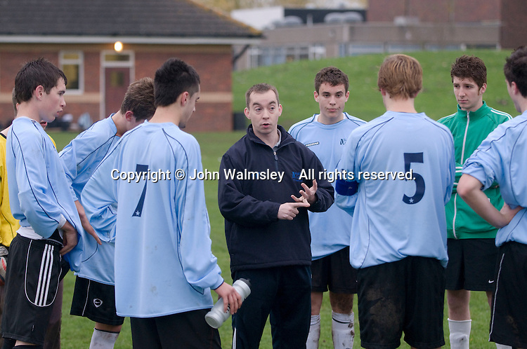 Team talk at half time. Football match against another local College.  Further Education College.