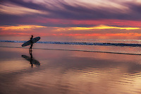 Surfer with Longboard Standing on the Beach in San Clemente